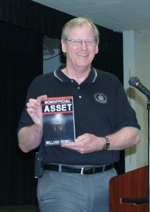 Bill Sewell shows us his novel. Note - no cloak, nor dagger.
